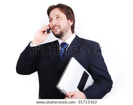 Young attractive male standing with laptop - stock photo