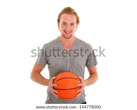 Young attractive male wearing a grey shirt, holding a basketball. White background. - stock photo