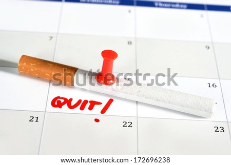Young attractive man breaking cigarette isolated on white background - stock photo