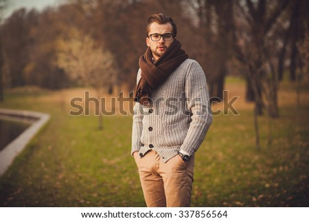 young attractive man in cardigan and glasses