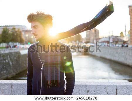Young attractive man in real authentic life on city street - stock photo