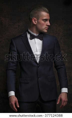 young attractive man on a dark background - stock photo