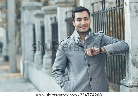 Young attractive man posing, outdoor - outsides. Good looking turkish guy  - stock photo