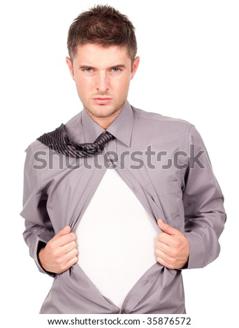 Young attractive man pulling a his t-shirt open - stock photo