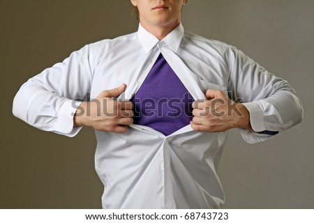 Young attractive man pulling a his t-shirt open