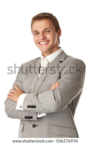 Young attractive man smiling brightly and standing with arms crossed - stock photo