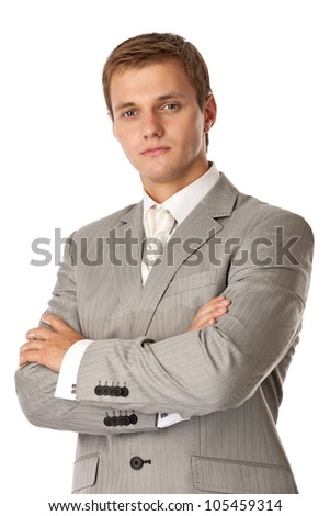 Young attractive man standing with arms crossed - stock photo