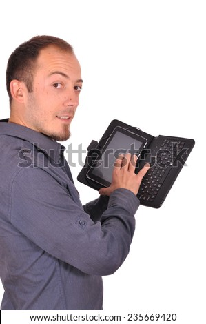 Young attractive man using his tablet computer - stock photo