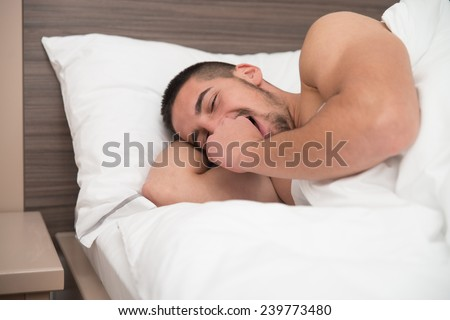Young Attractive Man Waking In Up - stock photo