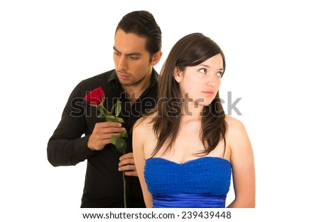 young attractive man with a rose ignored by beautiful woman isolated on white - stock photo
