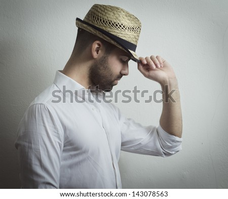 Young attractive man with modern hat