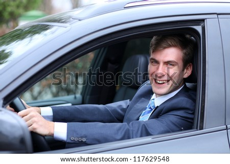 young attractive man young man in the car - stock photo