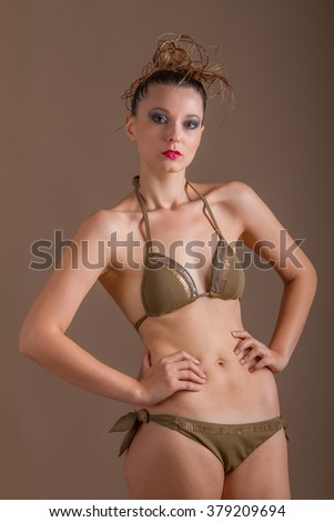 Young attractive model, studio shooting, young lady poses, model poses - stock photo