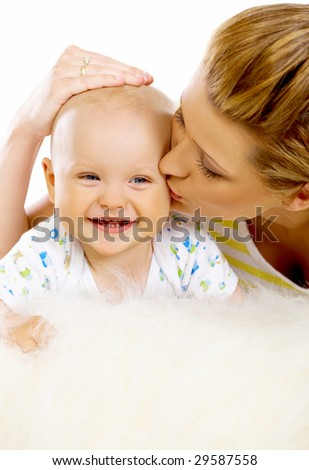 Young attractive mother kissing cute little baby - stock photo