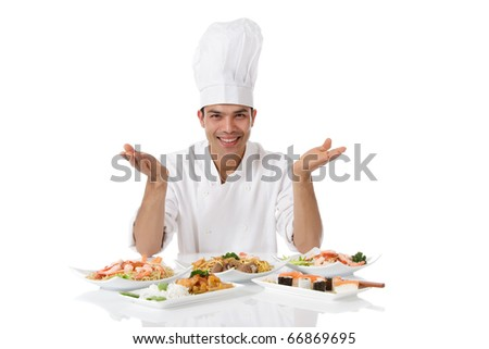 Young attractive nepalese man chef showing diversity of oriental meals on plates. Studio shot, white background.