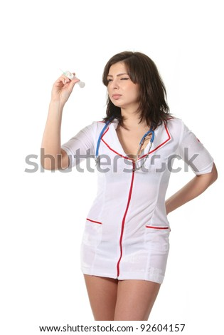 Young attractive nurse play darts with a syringe - stock photo
