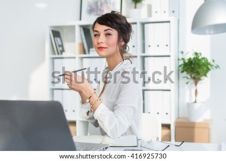 Young attractive office worker drinking cup of tea, having coffee break in the morning, getting ready for work day. - stock photo