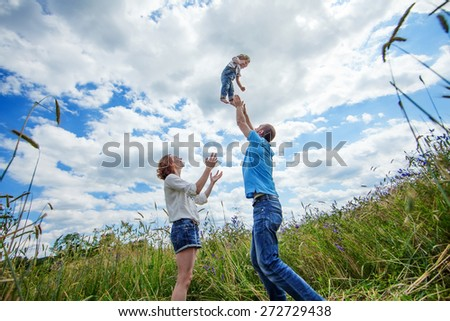 Young Attractive Parents and Child Portrait Outdoors - stock photo