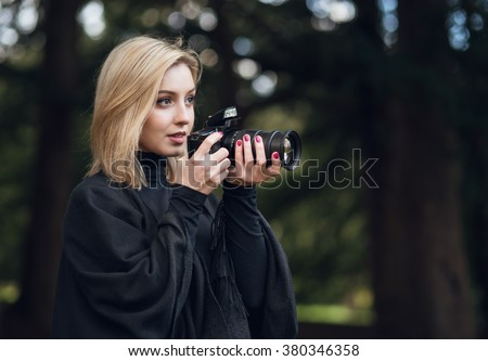 Young attractive photography student exploring the forest - stock photo