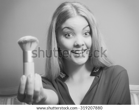 Young attractive pretty woman girl holding powder brush. Fashion and make up. Black and white photo. - stock photo