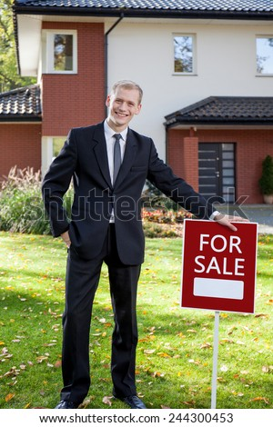 Young attractive real estate agent presenting the house for sale