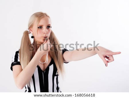 Young attractive referee whistling at white background - stock photo