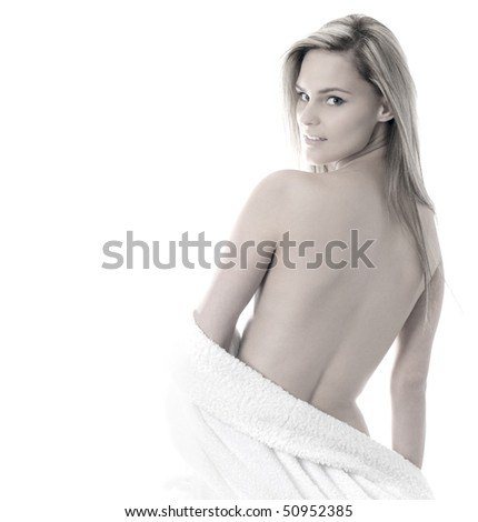Young attractive sexy blond in towel isolated on white - stock photo