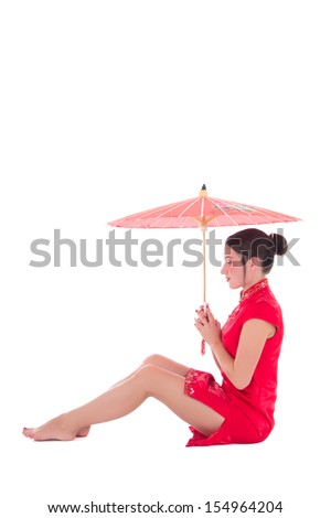 young attractive sitting woman in red japanese dress with umbrella isolated on white background - stock photo