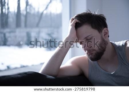 Young attractive sleepy man taking a short nap - stock photo