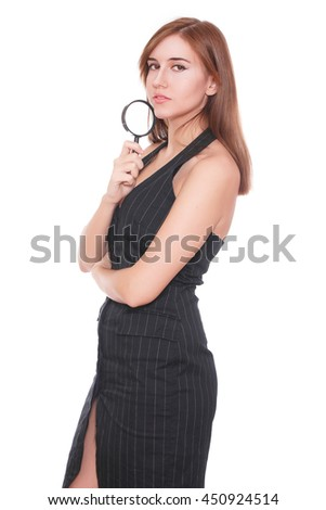 Young attractive smiling business woman using a magnifying glass, isolated on white background - stock photo