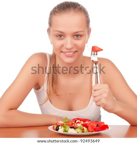 young attractive smiling caucasian woman eating vegetarian tomato and paprika salad, beauty young girl eating vegetable salad, portrait of attractive woman with plate of salad,isolated on white