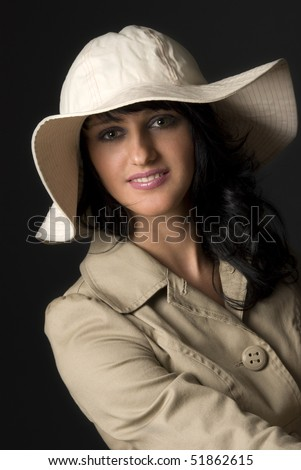 Young attractive smiling female wearing a summer hat.