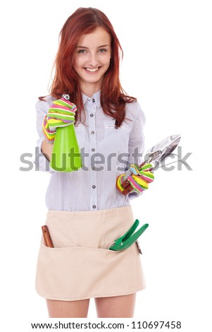 Young attractive smiling happy gardening girl with shovel and gloves, isolated on white - stock photo