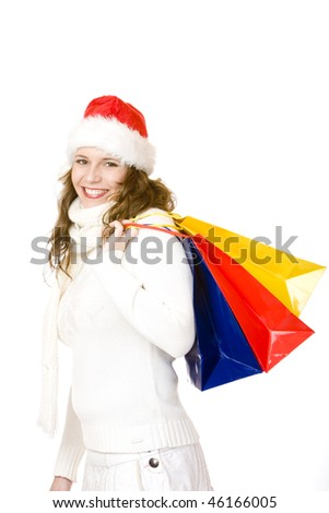 Young attractive smiling Santa Claus woman holding shopping bags. Isolated on white. - stock photo