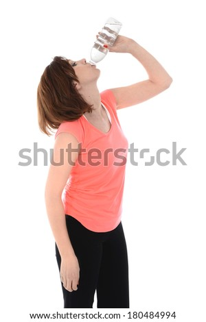 young attractive sport woman with red hair holding bottle and drinking mineral  water in bottle after gym session in healthy lifestyle , wellness and diet concept isolated on White background