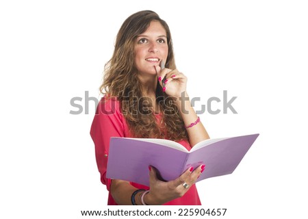young attractive student girl holding colorful exercise books