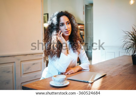 young attractive student talking on the phone during the lunch break.beautiful business woman preparing for a job interview - stock photo