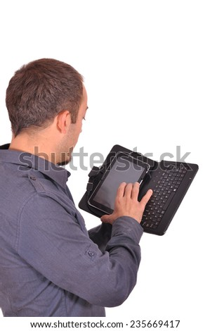 Young attractive student typing on his smart phone