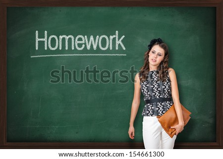 Young attractive teacher giving homework to students