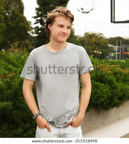 Young attractive teenage boy in urban background - stock photo