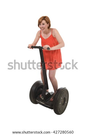 young attractive tourist woman in chic summer dress having fun riding electrical segway having fun driving isolated on white background in ecological transport concept - stock photo