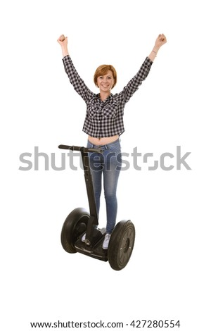 young attractive tourist woman rising arms up and free smiling happy riding electrical segway having fun driving isolated on white background in ecological transport concept - stock photo