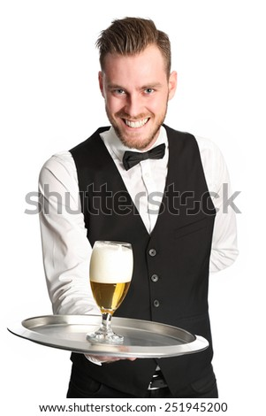 Young attractive waiter wearing a white shirt and black vest, serving a nice cold beer. White background.