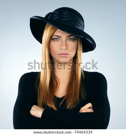 Young attractive widow over grey background - stock photo