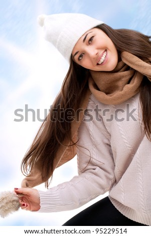 Young attractive winter girl having fun outdoors. - stock photo