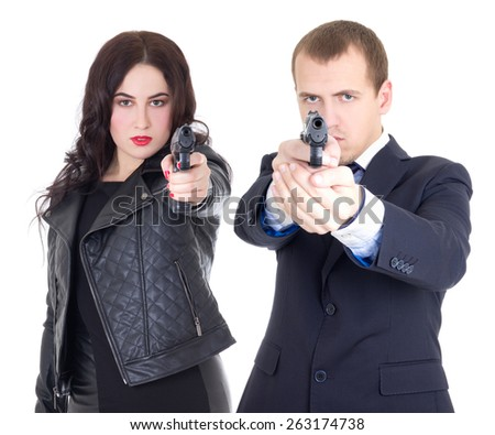 young attractive woman and handsome man posing with gun isolated on white background - stock photo