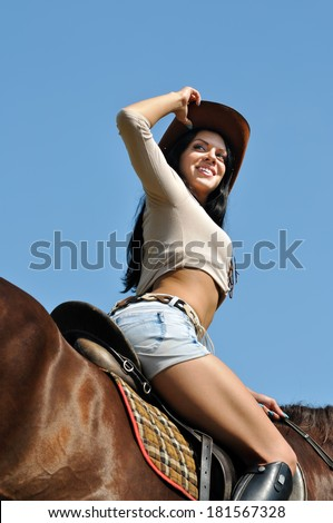 young attractive  woman and horse in sunny day - stock photo