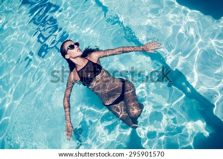 young attractive woman at pool - stock photo