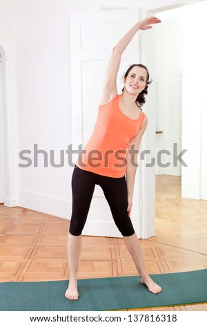 young attractive woman doing pilates yoga sport gymnastics