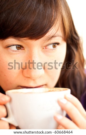 young attractive woman drinking coffee isolated - stock photo